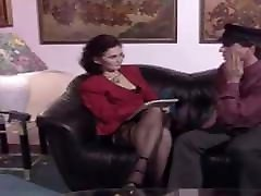 Lovely German mature brunette in stockings and heels fucked
