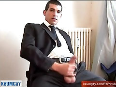 A straight guy in suite torusers get wanked his huge cock in spite of him!!
