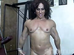 Mature female bodybuilder poses and flexes
