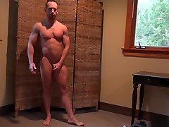 Bodybuilder gets rubdown and poses