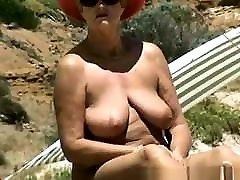 Oiled lady on nude beach