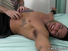 Dashing gay restrained on bed has his feet and body teased
