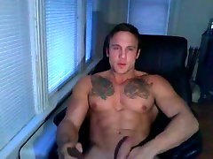 muscular stud jerks off on cam