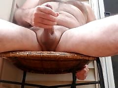 Jerking off naked on my deck. Big cum shot ..hairy bear