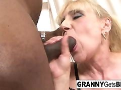 Blonde mature takes a facial after an interracial anal