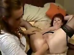 Sexy mature red head and young blonde anal fist each other