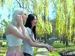 Teen lesbians kiss and lick pussy outdoors