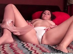 Horny soccer mom works her hairy cunt in ripped pantyhose