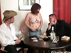 cumming inder table loses poker and swallows two cocks