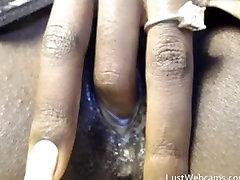 Ebony babe masturbates on webcam until she cums