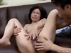 Mature Woman Getting Her Hairy Pussy Fingered By Guy On The Couch In The Si