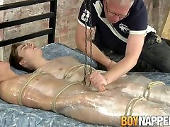 Dominant doing the opposite jerks off his wrapped up twinks