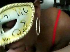 Masked ebony chick sucks giving head