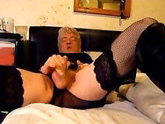 Cumming in black fishnets and shiny boots
