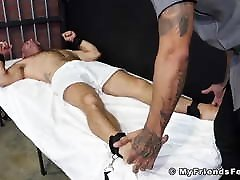 Bound prisoner endures foot torment and domination by guard