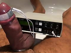 Sounded cock throbs with electro in the bath tub