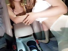 Asian Lesbians fucking in a car