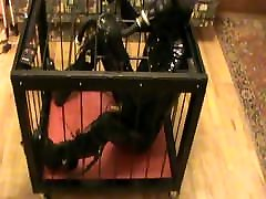 Caged rubberslave - 2