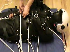 Restrained in a leahter insane sack