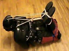 Hogtied in a straitjacket