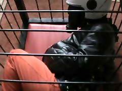 Straitjacketed prisoner in the cage