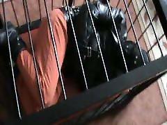 Caged prisoner in a straitjacket