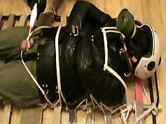 Restrained in a straitjacket and ect.