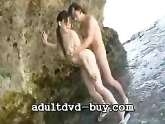 Japanese girl oral sex and make love on the beach