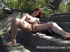 Red Bunny puts on naked outdoor striptease