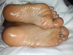 Oiled wifes foot filmed up close