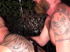 Ripped bear barebacks in hoist before cumshot