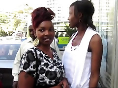 Ebony lesbians finger each other while taking a shower