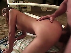 Sexy redheaded bitch loves to get down and dirty in the sand