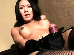Asian indian wa ita japan strokes her cock with gloves