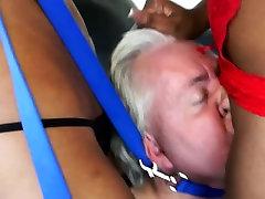 Two ebonies smoke into slaves face
