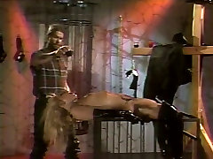 Kinky bitch in leather boots BDSM with two guys