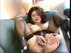 Asian mature in lingerie corset stimulated by vibrator