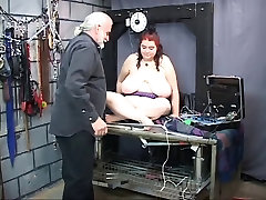 Fat ass slave shows off her enormous sagging tits on strange place
