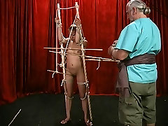 Gorgeous young swagraat xx com with perfect tits gets restrained by bdsm dungeon master