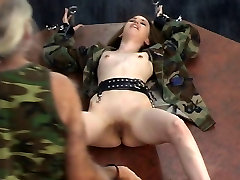 Young soldier girl in a cage is taken out for torture session on a bdsm wheel