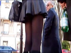 Sexy blonde in mini skirt pantyhose and boots