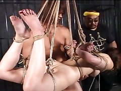 Amateur eaksersais xxx chick bound and suspended from ceiling