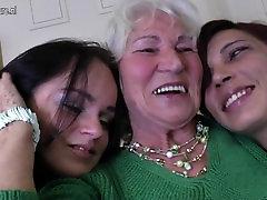 Granny Norma fucks two young lesbian girls