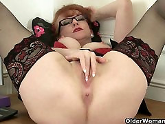 British milf Red works her sweet matured pussy