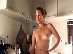 Sexy hairy MILF fingers herself in the kitchen