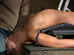 Busty in cowboy tied by a pillar and bodily whipped