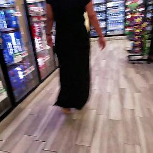 Mature xxl bum in dark-hued dress.