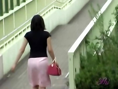 Warm Chinese stunner loses her micro-skirt during a street sharking.