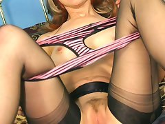 Lizzy shows off her panties and stockings