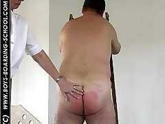 Searing paddling for chubby assed guy in pain